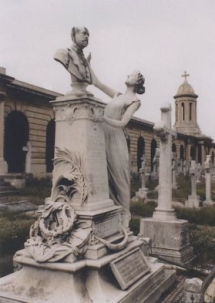 The monument on the grave of Sir Augustus Harris in Brompton Cemetery.  Since the photograph was taken the bust has been stolen and the female figure has lost her hands.  His parents and siblings are buried in a family grave there, as is his grandmother, the singer Elizabeth Feron.  Emma Albani and her husband Ernest Gye are buried nearby and his friends Henry Pettitt, Paul Merritt and William Terriss also lie in the same cemetery.