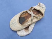 Ballet shoes worn by Nureyev, one signed in blue ink across the vamp. Private collection.