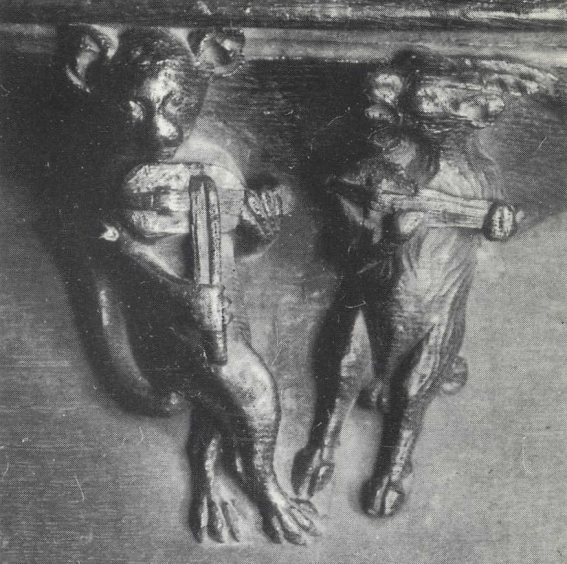 A cat fiddles while a goat plays a mandora (gittern) or plucked rebec, on a misericord, Hereford Cathedral, early 14th century.