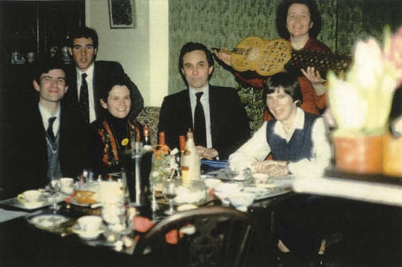 First meeting of the Confraternity of St James at Mary's house 15 Fernshaw Road on 13 January 1983.  Left  to Right : Ian Dodd, Peter Johnson, Jocelyn Rix, Robin Neillands (first Chairman), Patricia Quaife, and Mary holding up her organistrum.