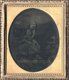 Mrs J. F. Robinson with her daughter (probably her youngest child Elizabeth). Ambrotype.  [c.1860].