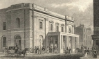 "Exterior, showing the Portico which had been added in 1820. Engraving by Thos. Dale after Thos. H. Shepherd, 16 February 1828 from Metropolitan Improvements : London in the Nineteenth Century, London,  ?1828. ""The grand Portico, in front of Drury-lane Theatre, is in a state of great forwardness, and will be completed on the opening of that establishment for the season on Monday [30 October] . . . . ."" Morning Post, 28 October 1820."