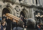 Paris, 12 January 1993. Nureyev's oak casket being carried from the Opéra after the memorial service. The ceremony had begun, at his request, with an extract from Bach's 'Art of Fugue.'  Photograph by Enid Theobald.
